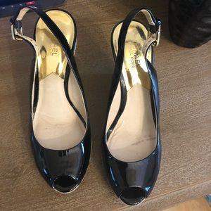 Michael Kors  black patent leather sandals.